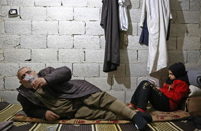 Displaced Huddle in a Basement as Winter Grips Syria