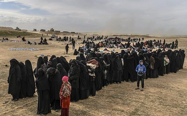 Islamic State fighters, families surrender after offensive in Syria