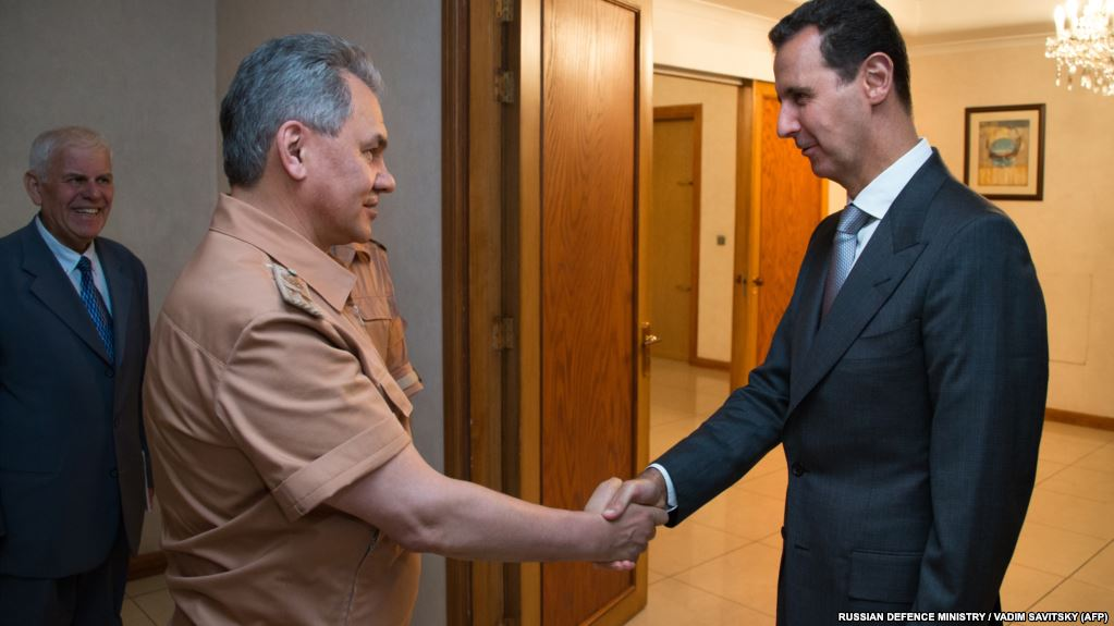 Russia Defense Minister Meets With Syria's Assad, Hands Him Message From Putin