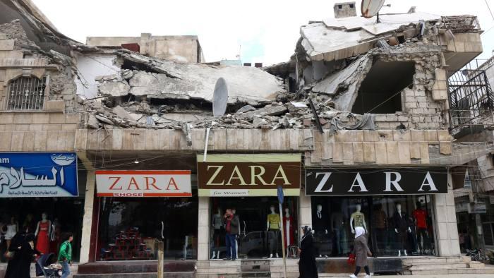 Syria's Assad puts pressure on business elite