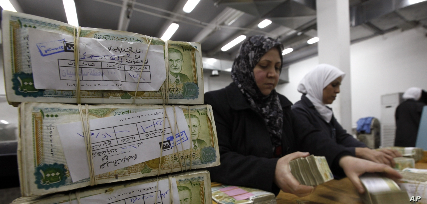 Syrian Currency Hovers Near Record Lows on Black Market