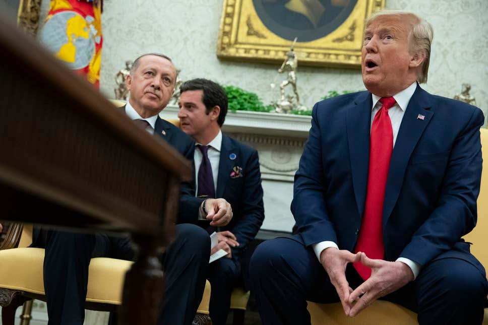 Erdogan says he handed back 'tough guy' letter to Trump as two leaders at odds over Kurds