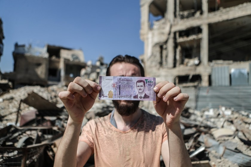 Syria (barely) survived a civil war. Can it weather the latest financial crisis?